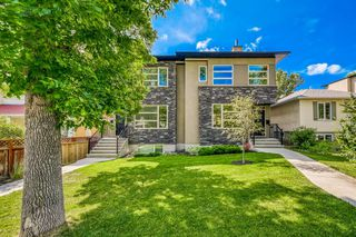 Main Photo: 211 29 Avenue NW in Calgary: Tuxedo Park Semi Detached for sale : MLS®# A1023226