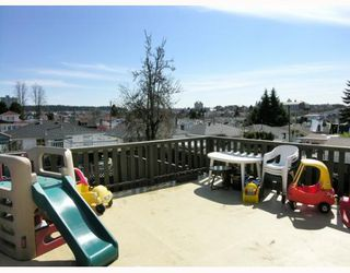 Photo 8: 4916 CHATHAM Street in Vancouver: Collingwood Vancouver East House for sale (Vancouver East)  : MLS®# V639689