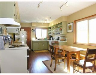 Photo 5: 4916 CHATHAM Street in Vancouver: Collingwood Vancouver East House for sale (Vancouver East)  : MLS®# V639689