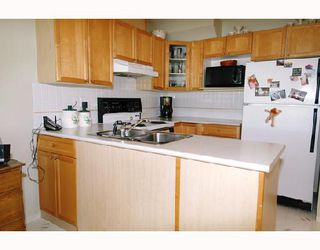 """Photo 5: 57 12099 237TH Street in Maple_Ridge: East Central Townhouse for sale in """"GABRIOLA"""" (Maple Ridge)  : MLS®# V656546"""