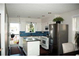 Photo 4: 2591 DUNDAS ST in Vancouver: Hastings East House for sale (Vancouver East)  : MLS®# V910166