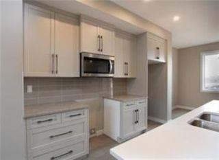 Photo 5: 1016 Lanark Boulevard SE: Airdrie Row/Townhouse for sale : MLS®# A1019250