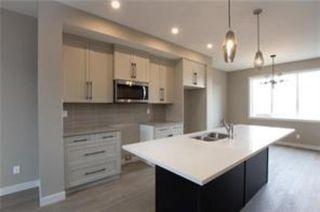 Photo 6: 1016 Lanark Boulevard SE: Airdrie Row/Townhouse for sale : MLS®# A1019250
