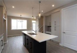 Photo 4: 1016 Lanark Boulevard SE: Airdrie Row/Townhouse for sale : MLS®# A1019250