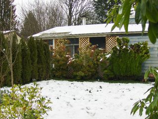 Photo 1: 7728 SWIFT Drive in Mission: Mission BC House for sale : MLS®# F2800451