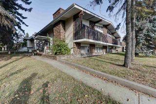 Photo 2: 7516/7518 105 Avenue NW in Edmonton: Zone 19 House Duplex for sale : MLS®# E4177544