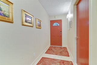 Photo 2: 143 Wolf Willow Crescent in Edmonton: Zone 22 Townhouse for sale : MLS®# E4184793