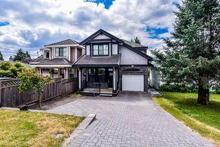 Photo 1: 950 DELESTRE Avenue in Coquitlam: Maillardville House 1/2 Duplex for sale : MLS®# R2426856