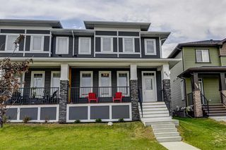 Photo 1: 604 EVANSTON Link NW in Calgary: Evanston Semi Detached for sale : MLS®# A1021283