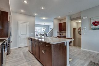Photo 9: 604 EVANSTON Link NW in Calgary: Evanston Semi Detached for sale : MLS®# A1021283
