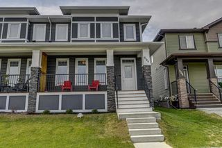 Photo 2: 604 EVANSTON Link NW in Calgary: Evanston Semi Detached for sale : MLS®# A1021283