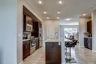 Photo 8: 604 EVANSTON Link NW in Calgary: Evanston Semi Detached for sale : MLS®# A1021283