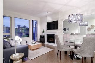 "Photo 1: 525 119 W 22ND Street in North Vancouver: Central Lonsdale Condo for sale in ""Anderson Walk"" : MLS®# R2487570"