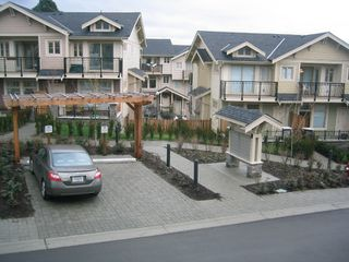 Photo 2: 57 245 FRANCIS Way in New_Westminster: Fraserview NW Townhouse for sale (New Westminster)  : MLS®# V681903