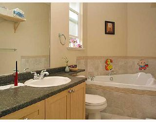 Photo 7: 825 NORTH Road in Coquitlam: Coquitlam West House for sale : MLS®# V704750