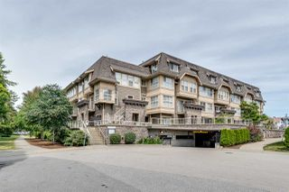 "Photo 1: 208 2110 ROWLAND Street in Port Coquitlam: Central Pt Coquitlam Townhouse for sale in ""Aviva on the Park"" : MLS®# R2442620"