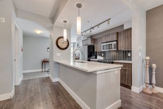 "Photo 2: 208 2110 ROWLAND Street in Port Coquitlam: Central Pt Coquitlam Townhouse for sale in ""Aviva on the Park"" : MLS®# R2442620"