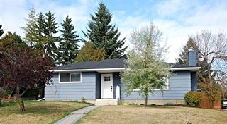 Photo 1: 716 CANTREE Road SW in Calgary: Canyon Meadows Detached for sale : MLS®# A1037866