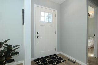 Photo 2: 716 CANTREE Road SW in Calgary: Canyon Meadows Detached for sale : MLS®# A1037866
