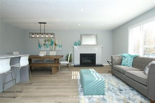 Photo 5: 716 CANTREE Road SW in Calgary: Canyon Meadows Detached for sale : MLS®# A1037866