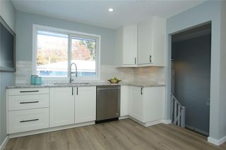 Photo 16: 716 CANTREE Road SW in Calgary: Canyon Meadows Detached for sale : MLS®# A1037866