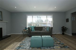 Photo 7: 716 CANTREE Road SW in Calgary: Canyon Meadows Detached for sale : MLS®# A1037866