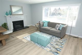 Photo 12: 716 CANTREE Road SW in Calgary: Canyon Meadows Detached for sale : MLS®# A1037866