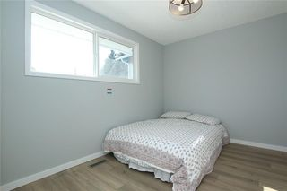 Photo 22: 716 CANTREE Road SW in Calgary: Canyon Meadows Detached for sale : MLS®# A1037866