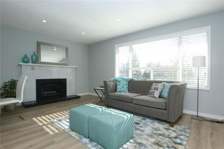 Photo 6: 716 CANTREE Road SW in Calgary: Canyon Meadows Detached for sale : MLS®# A1037866