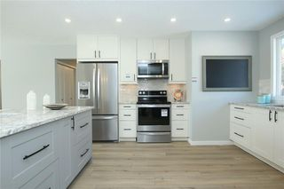 Photo 14: 716 CANTREE Road SW in Calgary: Canyon Meadows Detached for sale : MLS®# A1037866
