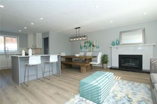 Photo 4: 716 CANTREE Road SW in Calgary: Canyon Meadows Detached for sale : MLS®# A1037866