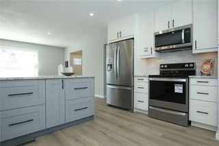 Photo 15: 716 CANTREE Road SW in Calgary: Canyon Meadows Detached for sale : MLS®# A1037866