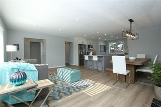 Photo 10: 716 CANTREE Road SW in Calgary: Canyon Meadows Detached for sale : MLS®# A1037866