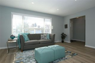 Photo 8: 716 CANTREE Road SW in Calgary: Canyon Meadows Detached for sale : MLS®# A1037866