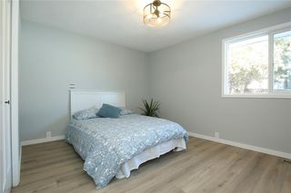 Photo 18: 716 CANTREE Road SW in Calgary: Canyon Meadows Detached for sale : MLS®# A1037866