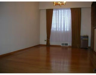 Photo 3: 6995 HALLIGAN Street in Burnaby: Upper Deer Lake House for sale (Burnaby South)  : MLS®# V686559