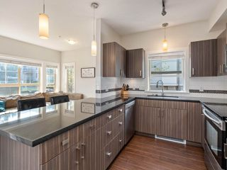 """Photo 7: 105 20219 54A Avenue in Langley: Langley City Condo for sale in """"SUEDE"""" : MLS®# R2507950"""