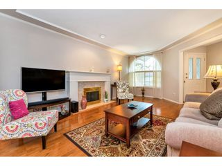 "Photo 3: 6139 W BOUNDARY Drive in Surrey: Panorama Ridge Townhouse for sale in ""LAKEWOOD GARDENS"" : MLS®# R2452648"