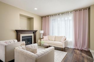 Photo 8: 722 56 Avenue SW in Calgary: Windsor Park Row/Townhouse for sale : MLS®# A1020099