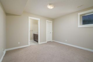 Photo 21: 722 56 Avenue SW in Calgary: Windsor Park Row/Townhouse for sale : MLS®# A1020099