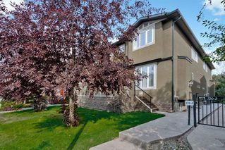 Photo 1: 722 56 Avenue SW in Calgary: Windsor Park Row/Townhouse for sale : MLS®# A1020099