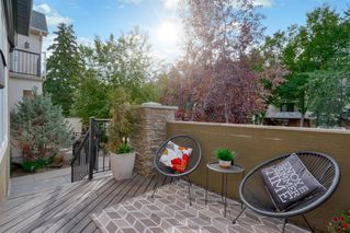Photo 3: 722 56 Avenue SW in Calgary: Windsor Park Row/Townhouse for sale : MLS®# A1020099