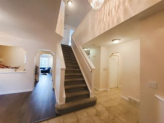 Photo 3: 104 Cougar Ridge Drive SW in Calgary: Cougar Ridge Detached for sale : MLS®# A1050909