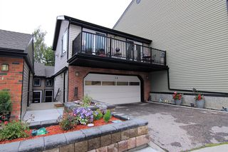 Main Photo: 14 448 Strathcona Drive SW in Calgary: Strathcona Park Row/Townhouse for sale : MLS®# A1062533