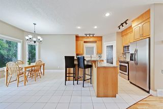 Photo 8: 165 STRATHLEA Place SW in Calgary: Strathcona Park Detached for sale : MLS®# A1025551