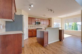Photo 6: 144 Tuscany Meadows Heath NW in Calgary: Tuscany Detached for sale : MLS®# A1030703