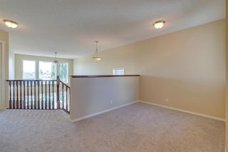 Photo 15: 144 Tuscany Meadows Heath NW in Calgary: Tuscany Detached for sale : MLS®# A1030703