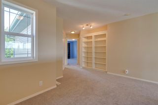 Photo 17: 144 Tuscany Meadows Heath NW in Calgary: Tuscany Detached for sale : MLS®# A1030703