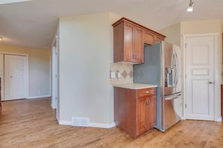 Photo 11: 144 Tuscany Meadows Heath NW in Calgary: Tuscany Detached for sale : MLS®# A1030703