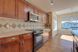 Photo 7: 144 Tuscany Meadows Heath NW in Calgary: Tuscany Detached for sale : MLS®# A1030703